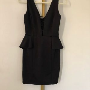 Black caged front peplum dress
